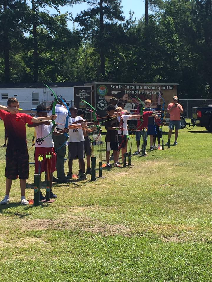 Boys shooting archery at Camp